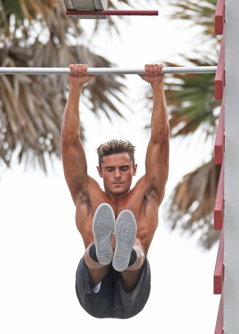 Zac Efron shows off his amazing abs on a Lifeguard obstacle course the set of 'Baywatch' in Miami