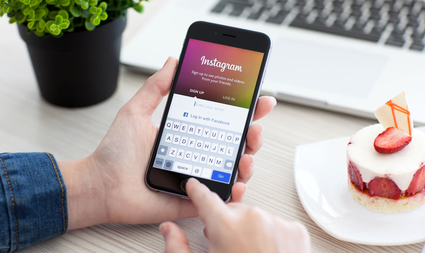 Woman holding iPhone 6 Space Gray with service Instagram